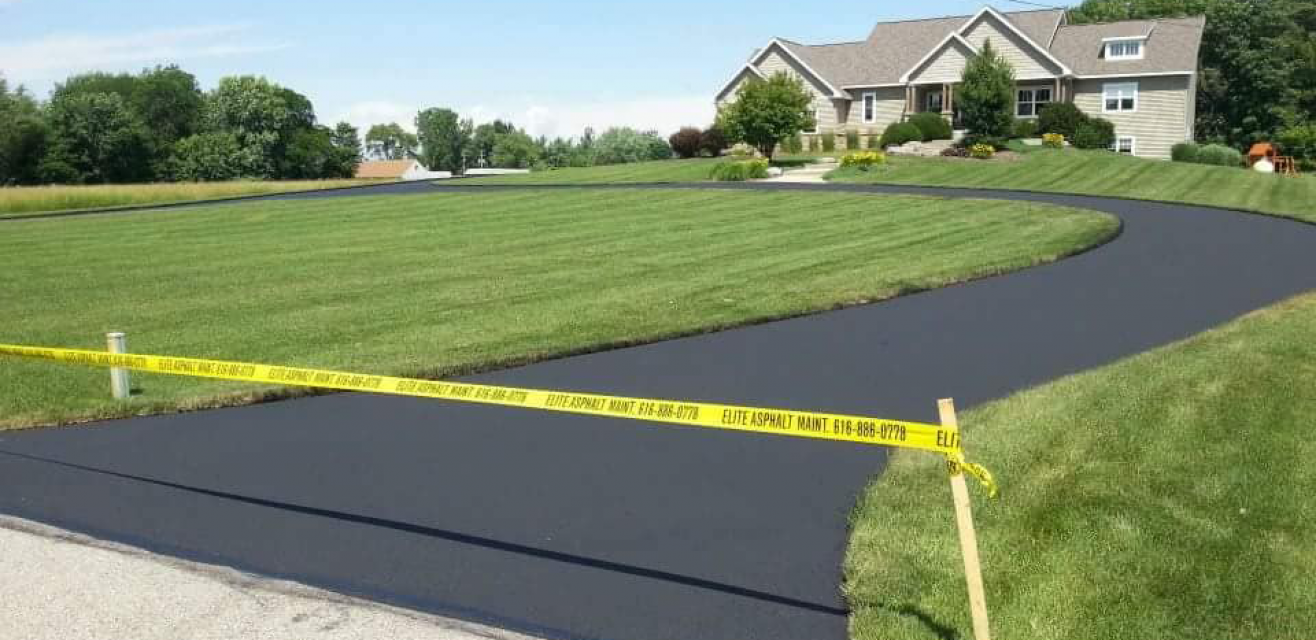 Residential-Sealed-Driveway-EliteAsphaltMaintenance-Faded